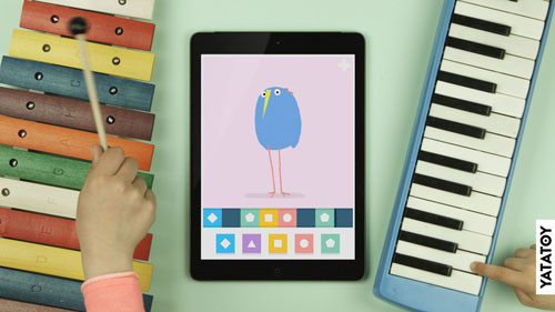 iPad and Bird and 2 Kids playing with a xylophone and a melodica along to the music
